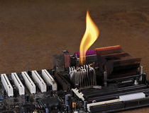 Melting heat sink on computer board Royalty Free Stock Images