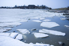 Melting ice. In spring on the coast Stock Photography