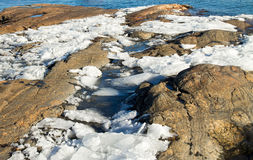 Melting ice on the Baltic Sea shore Royalty Free Stock Photos