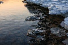 Melting ice coast stock photos