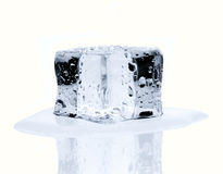 Melting ice cube isolated on white Royalty Free Stock Photography