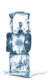 Melting ice cube stack with water Stock Image