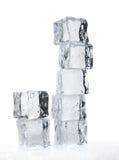 Melting ice cubes. Over white closeup shallow dof Royalty Free Stock Photos