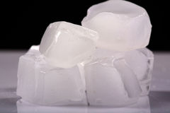 Melting ice cubes. With black background royalty free stock images