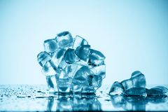 Melting ice cubes. On white with drops Royalty Free Stock Photography
