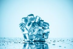 Melting ice cubes. On white with drops Royalty Free Stock Photo