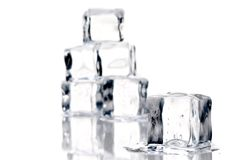 Melting ice cubes on a relective surface Royalty Free Stock Photo