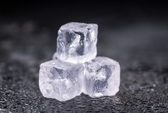 Melting Ice cubes on a vintage slate slab selective focus Stock Image
