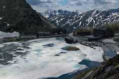 The melting ice on the lake high in the mountains. The Alps pass Royalty Free Stock Image