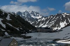 The melting ice on the lake high in the mountains. The Alps pass Royalty Free Stock Photos