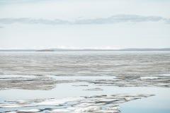 Melting Ice on Lake Surface. Nature Background Stock Photo