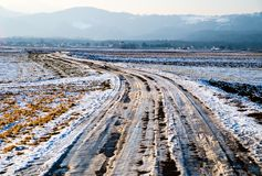 Melting ice. On rural road Stock Images