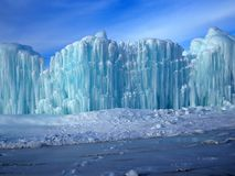 Melting Ice And Blue Sky. Melting ice during the month of February against a blue sky with light clouds Stock Photos