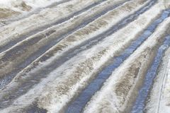 The melting ice on the road, the Russian roads Stock Photos