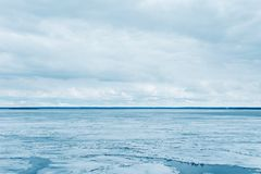 Melting ice on the sea and cloudy sky stock photography