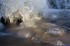 Melting ice in a mountain creek. Melting ice in spring in a mountain creek with beautiful ice formations Royalty Free Stock Photography