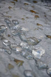 Melting Ice. Ice melting on a tent floor Royalty Free Stock Photo