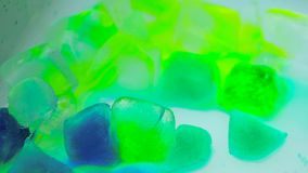 Melting ice time lapse. Colored ice cubes melting stock video footage