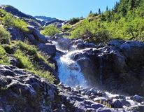 A waterfall cross on Heliotrope Ridge trail, Mount Baker Stock Photos