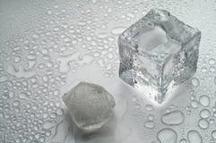 Melting ice on white Stock Photos