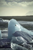 Melting iceberg. Washed up on the beach near Jokulsarlon lagoon Iceland Stock Photos