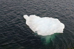 Melting iceberg drifting water of Atlantic Ocean Stock Image