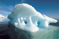 Melting iceberg and water Stock Photos