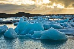Melting of icebergs at Jokulsarlon glacier lagoon at sunset Royalty Free Stock Photography
