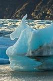 Melting of icebergs at Jokulsarlon glacier lagoon at sunset Royalty Free Stock Photo