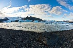 Melting of icebergs at Jokulsarlon glacier lagoon at sunset Royalty Free Stock Photos