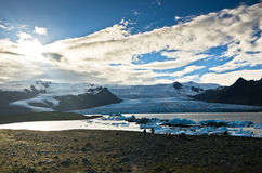 Melting of icebergs at Jokulsarlon glacier lagoon at sunset Royalty Free Stock Images