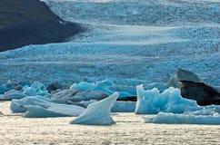 Melting of icebergs at Jokulsarlon glacier lagoon at sunset Stock Images