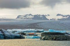 Melting of icebergs at Jokulsarlon glacier lagoon at sunset Stock Photos