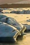 Melting of icebergs in Jokulsarlon glacier lagoon at sunset Royalty Free Stock Photos