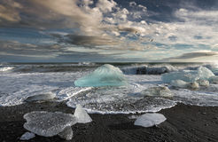 Melting Icebergs in the Sea. Melting icebergs near Jökulsarlon Glacier Lagoon in southern Iceland symbolizing the global warming Stock Images