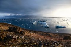 Melting icebergs in Yokulsarlon glacial lake during sunset Stock Images