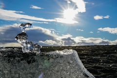 Melting iceblock in the sunshine stock photo