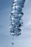 Melting icicle and drop of water Stock Photos