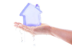 Melting icy house Royalty Free Stock Image