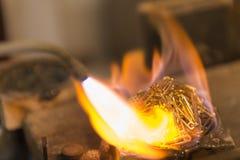 The melting of jewelery Stock Photography