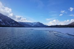 Melting Kanas Lake. The lake of kanas, thick in the early summer, is melting Stock Image