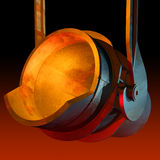 Melting ladle. On the dark red background Royalty Free Stock Photography