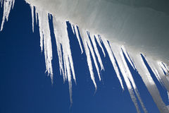 Melting icicle. Melting long icicles hanging from the ceiling of an ice cave stock photos