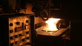 Melting of metal in a steel plant. High temperature in the melting furnace. Metallurgical industry. Melting of metal in a steel plant. Factory for the stock video footage