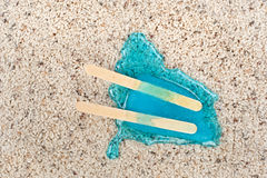 Melting popsicle on carpet. Royalty Free Stock Photography