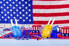 Melting popsicles on patriotic background Royalty Free Stock Photography