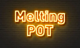 Melting pot neon sign on brick wall background. Royalty Free Stock Image