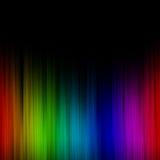 Melting Rainbow. A background of the raindow melting into a black background setting Stock Photo