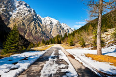 Melting Snow. On the Mountainous Road in the Italian Alps Royalty Free Stock Image