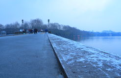 Melting Snow at Broken(duanqiao) Bridge at early morning. Melting Snow at Broken(duanqiao) Bridge is one of  Ten Sights in West Lake Royalty Free Stock Photos
